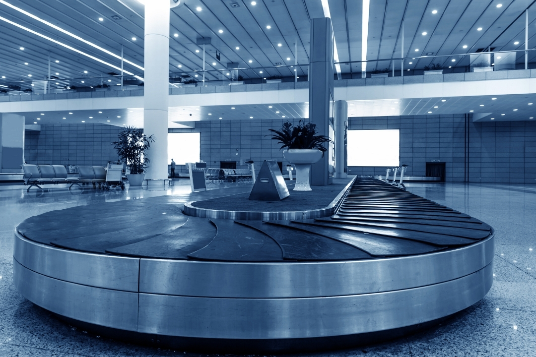 An empty baggae carousel at an airport