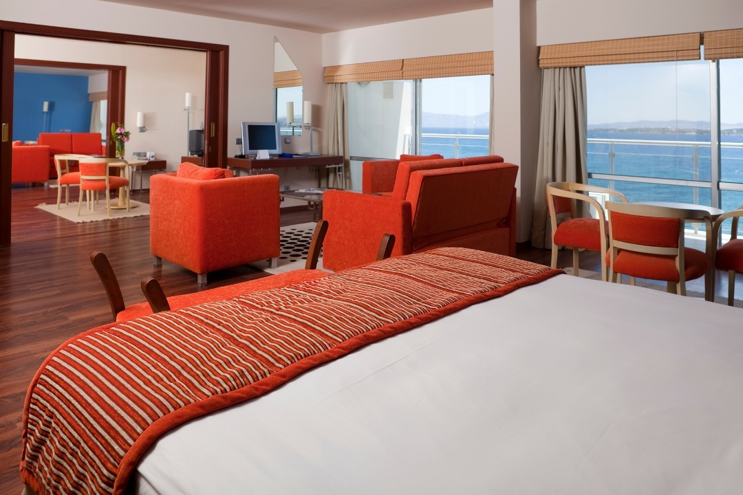 A large and brightly lit hotel room suitable for larger families