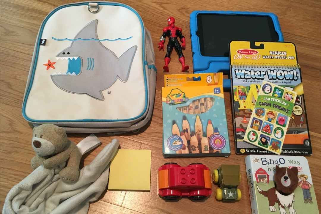 A selection of toys for a toddlers backpack