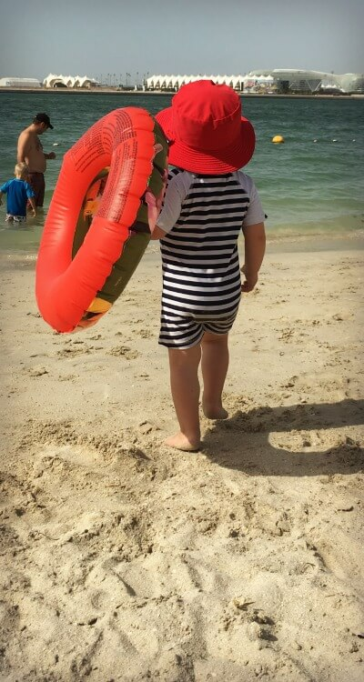 Baby in Snapper Roack UV Sun Suit | Summer sun protection for babies | OurGlobetrotters