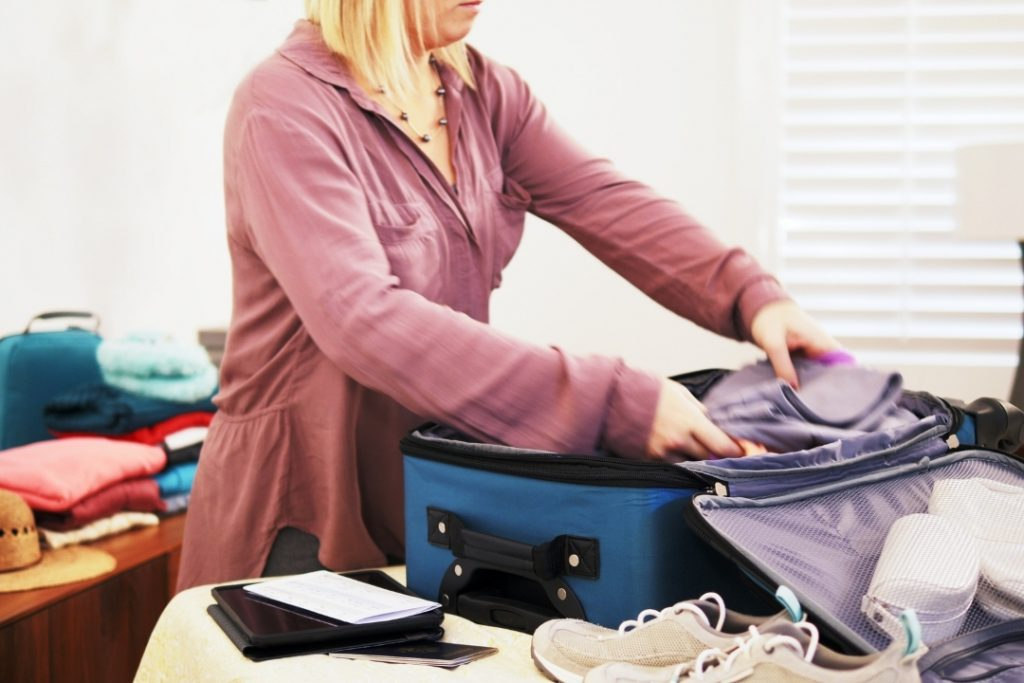 lady packing a suitcase