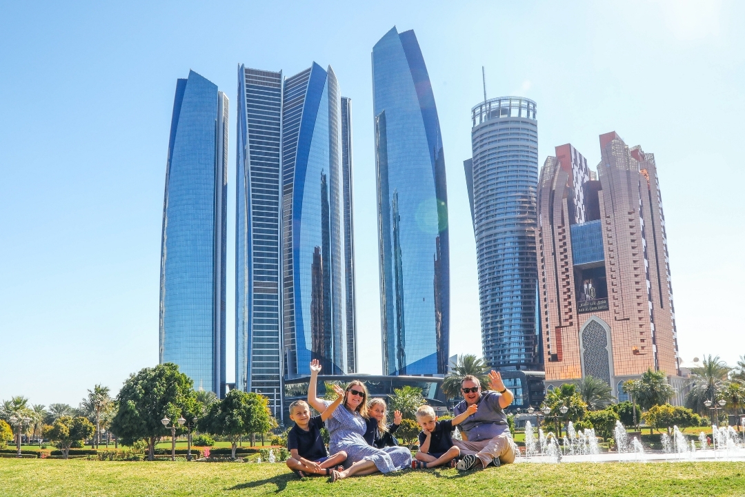Our Globetrotters - family portrait by Localgrapher in front of Etihad Towers Abu Dhabi