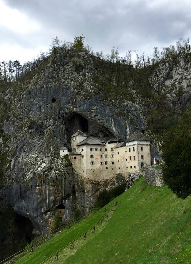 Predjama Castle Slovenia | Family Travel Hidden Gems | OurGlobetrotters.Com