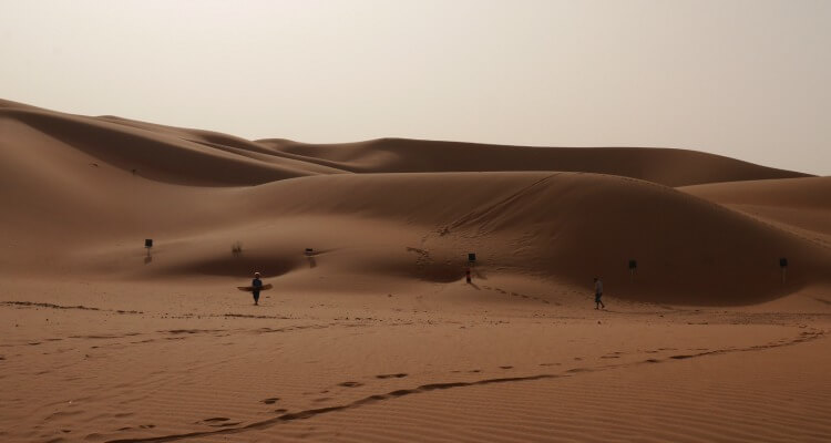 Sand boarding at a desert camp in the UAE