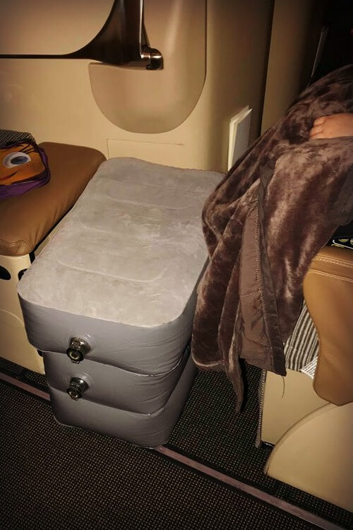kooshy Kids leg pillow fully inflated in business class