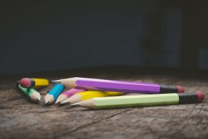 pencils on a wooden table dark background