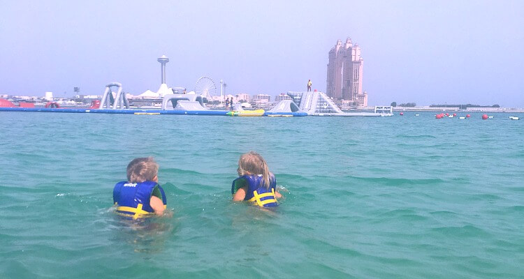 Swimming out to AquaFun Abu Dhabi Corniche inflatable play park | Review by Our Globetrotters