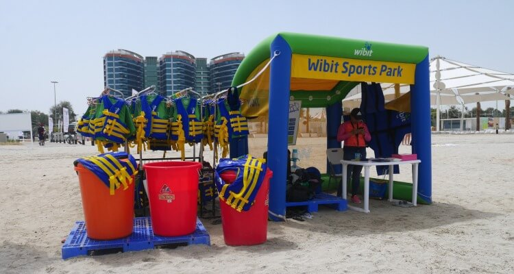 Sign in at the beach hut for AquaFun Abu Dhabi Corniche inflatable play park | Review by Our Globetrotters