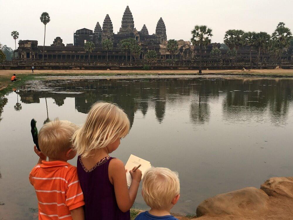 Children admiring Angkor Wat Siem Reap Cambodia