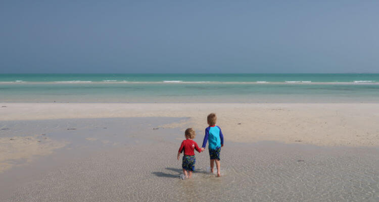Kids playing on beach, expat life in Doha