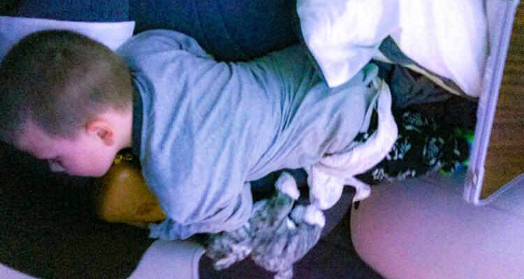 Kids sleeping Qatar Airways business class 02