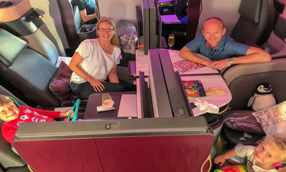 Famnily enjoying the Q Suites on Qatar Airways | Family Flying review on Our Globetrotters