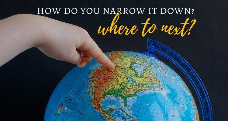 Child poining to a globe, wording where to next helping you narrow down your bucket list