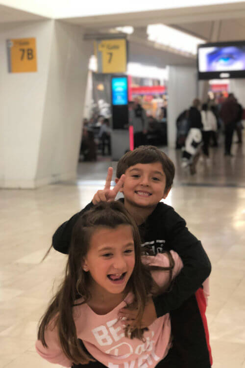 Kids at airport ready to fly overnight with Norwegian