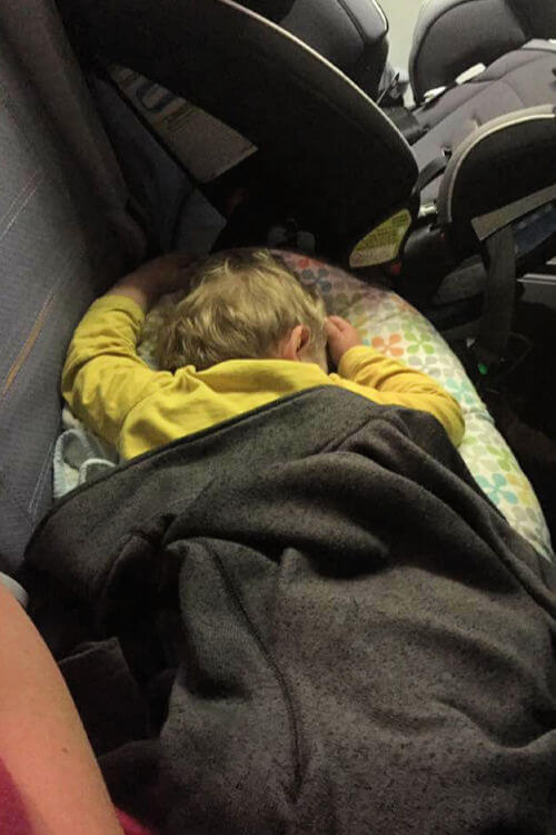 Infant sleeping on board Lufthansa flight