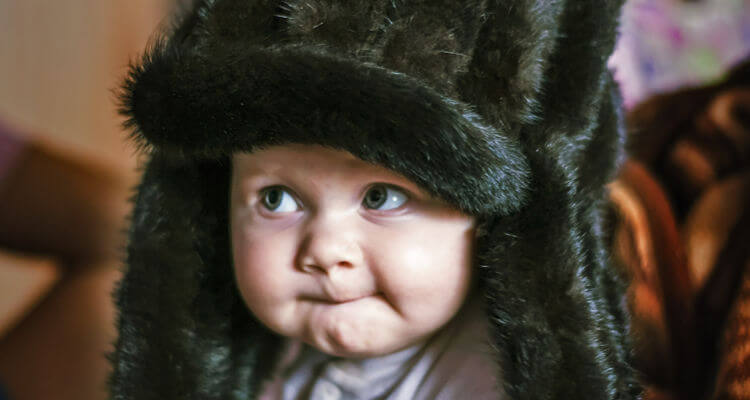 Baby dressed for winter weather   what to buy baby for cold climates