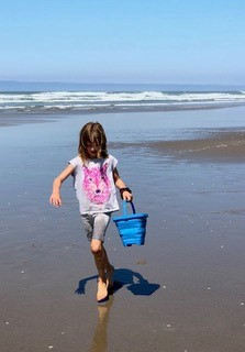 Playing on the beach - family travel fever with a collapsible bucket