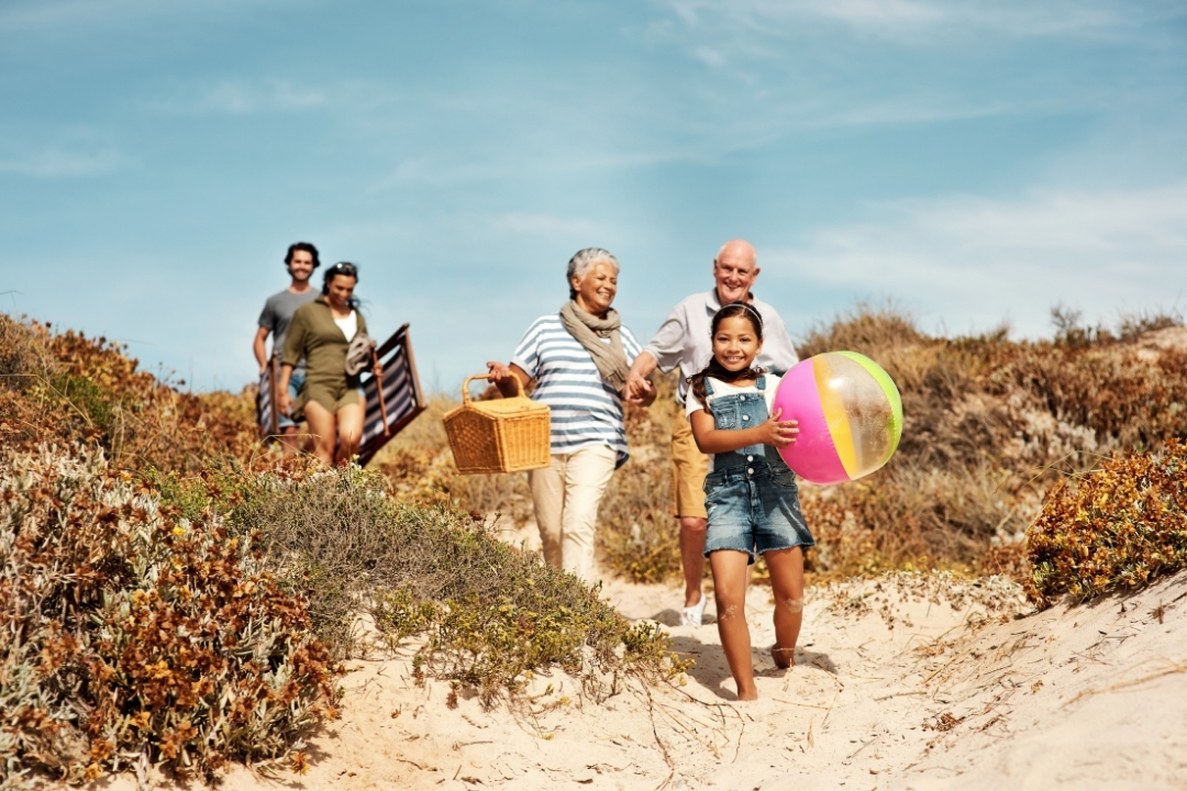 multigeneration family leaving the beach on summer vacation