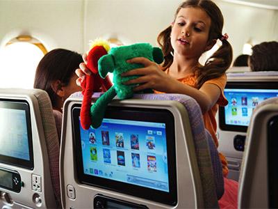 Child playing wtih toys on Emirates Flight