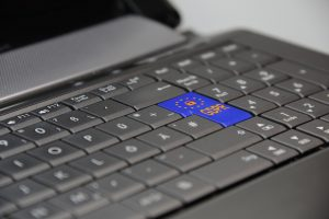 A laptop computer showing European GDPR button