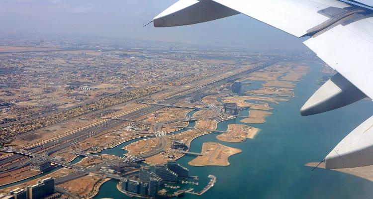 Plane taking off over Abu Dhabi's Al Raha Beach