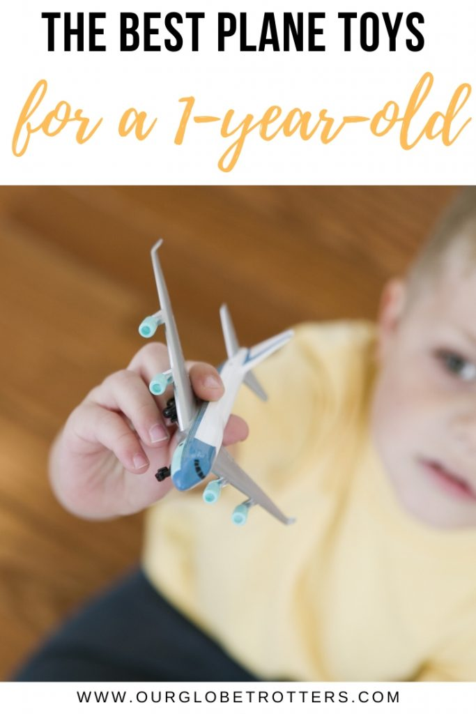 Child holding airplane