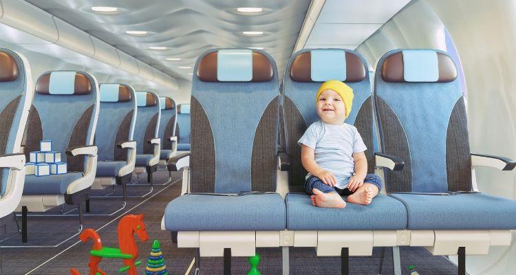 Cute baby sitting on plane