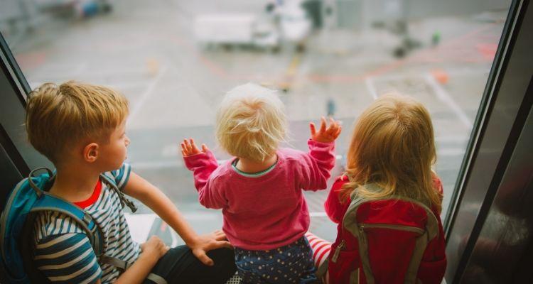 Kids waiting at an airport