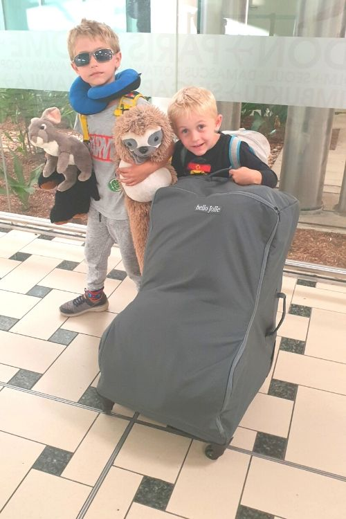Kids helping to pull along the Hello Jolie Car Seat Travel Bag