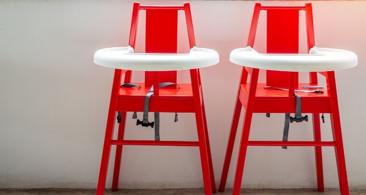 2 red high chairs
