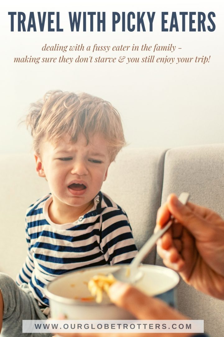 A younf child crying beinf fed food he does not like: guide to travelling with a fussy eater