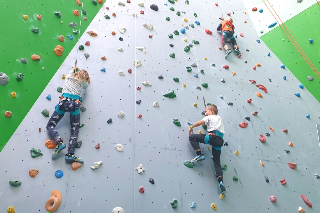 3 children on the beginner climbing walls at CLYMB Abu Dhabi