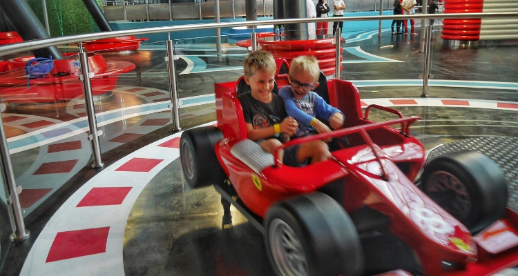 Boys enjoying the Speeedway Race ride at Ferrari World