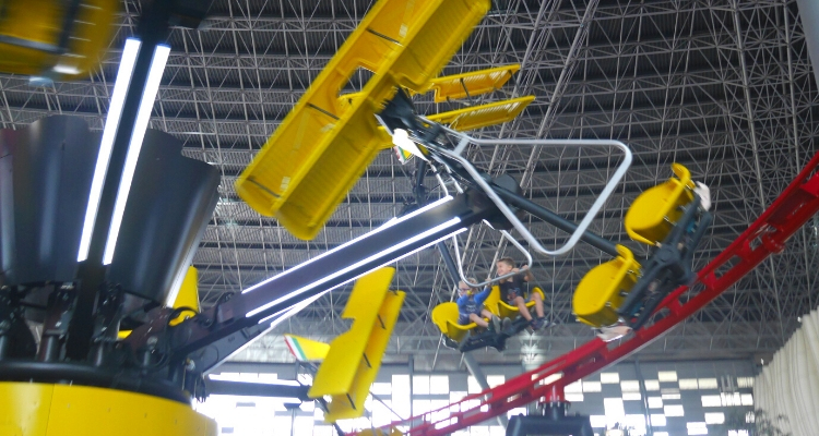 Boys riding the Flying Wings ride at Ferrari World Abu Dhabi
