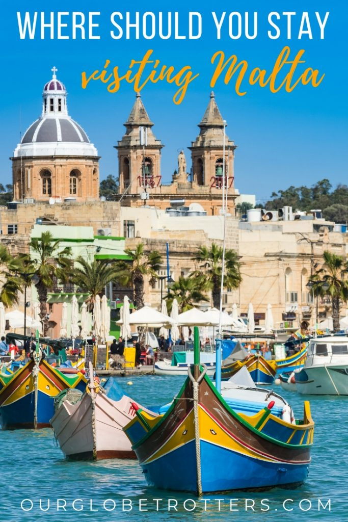 Colourful boats in a harbour in Malta