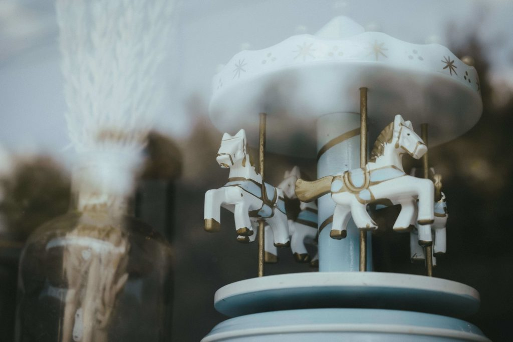 Canva - White and Blue Ceramic Carousel Figurine