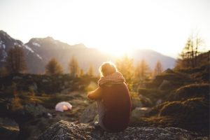 Wild camping lady outside at sunrise