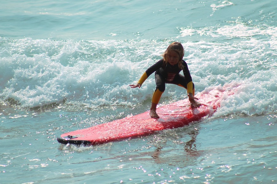 Child surfing Great Ocean Road Victoria