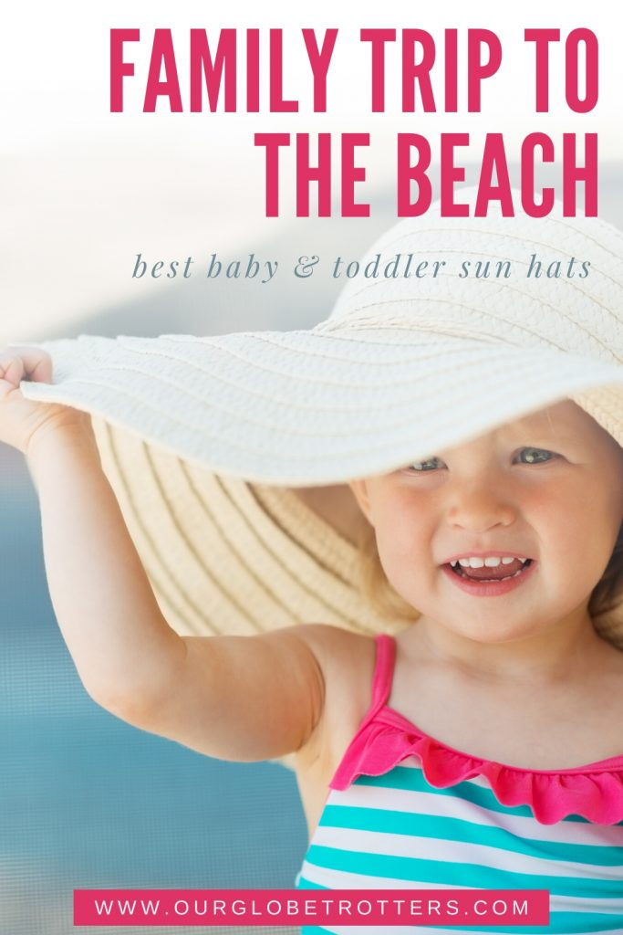 baby wearing oversized sun hat