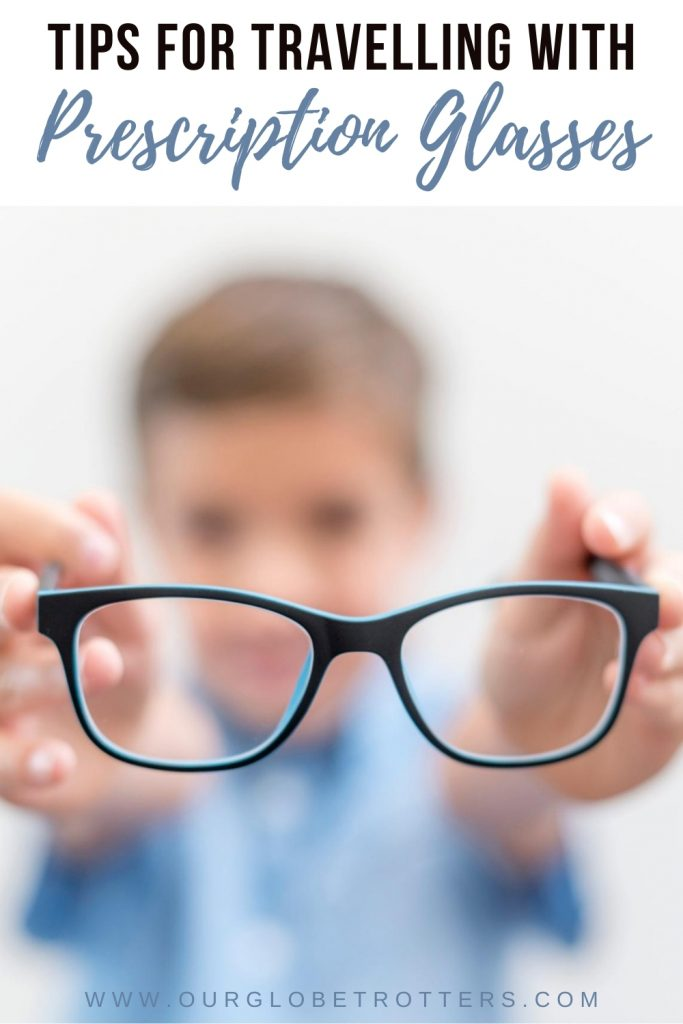 child holding a pair of blue prescription glasses