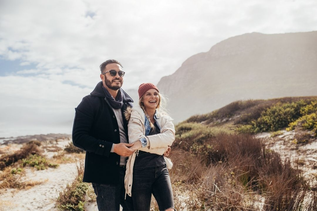 Couple in warm coats enjoying themselves on engagement
