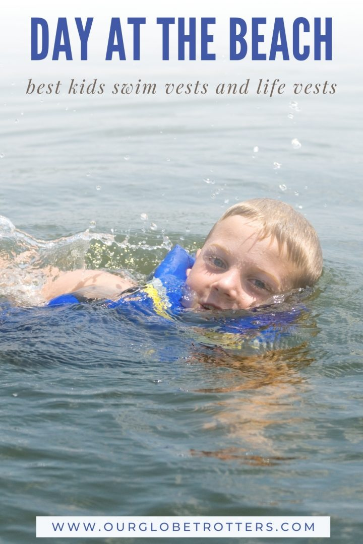 Child swimming in open water with a safety device