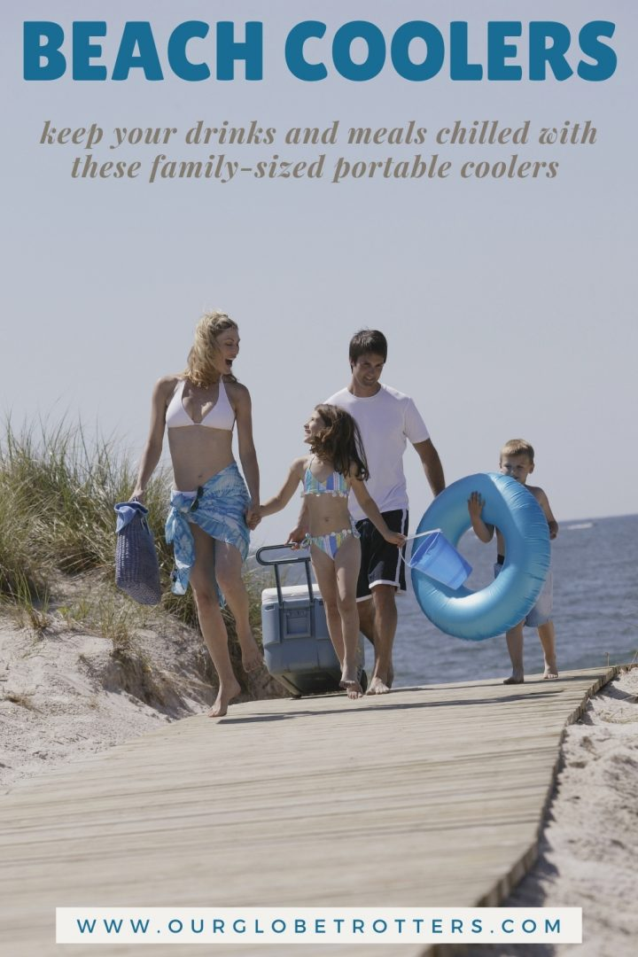 family leaving the beach with a wheeled beach cooler