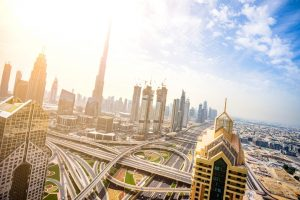 overhead view of the busy freeways and burj khalifa in dubai