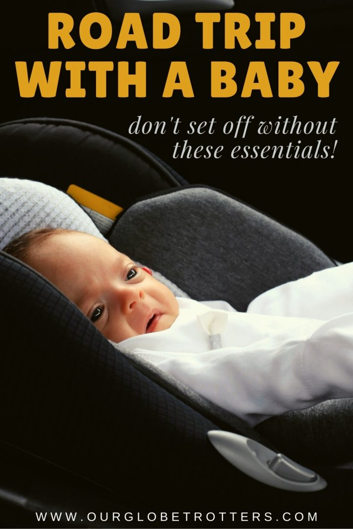 tiny newborn baby in a car seat - text overlay road trip with a baby