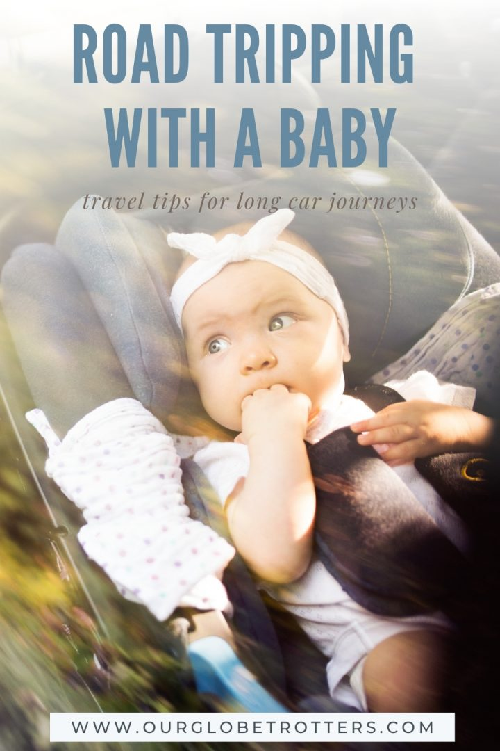 cute baby in a car seat with text overly - road tripping with a baby