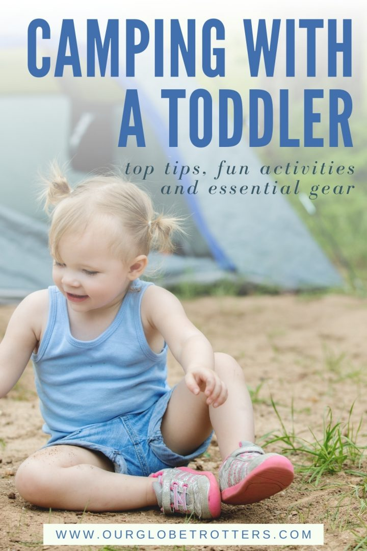 Toddler playing in front of a tent