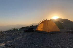 tent in the mountains at sunrise Oman
