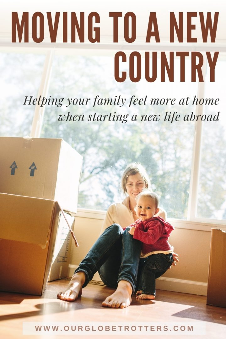 mother and child sitting with moving boxes