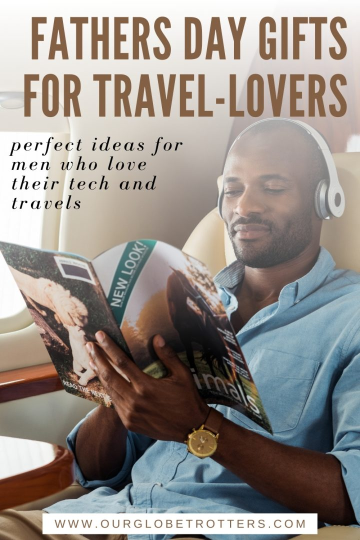 man traveling first class with headphones and a magazine - Fathers Day gifts for travel lovers
